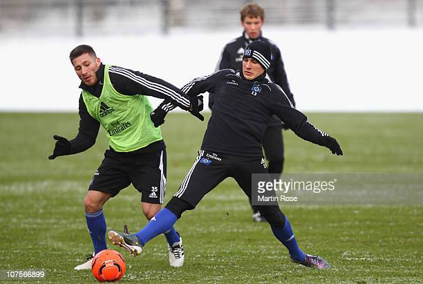 Tunay Torun and Robert Tesche battle for the ball during the Hamburger SV training session at Imtech Arena on December 14 2010 in Hamburg Germany