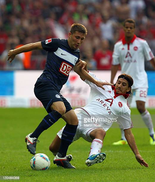Tunay Torun of Berlin and Almog Cohen of Nuernberg battle for the ball during the Bundesliga match between Hertha BSC Berlin and 1 FC Nuernberg at...