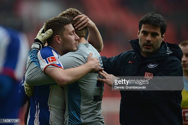 Tunay Torun of Berlin and teammate Thomas Kraft hug after the Bundesliga match between Bayer 04 Leverkusen and Hertha BSC Berlin at BayArena on April...