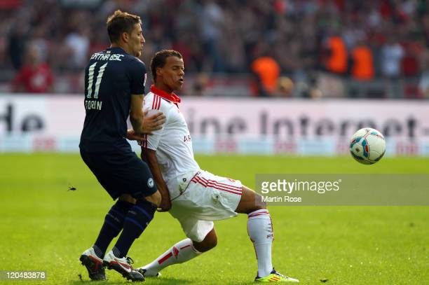 Tunay Torun of Berlin and Timothy Chandler of Nuernberg battle for the ball during the Bundesliga match between Hertha BSC Berlin and 1. FC Nuernberg...