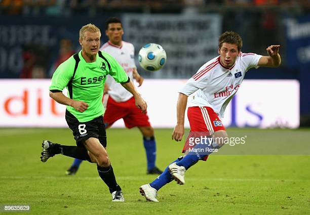 Tunay Torun of Hamburg and Soeren Pedersen of Randers compete for the ball during the UEFA Europa League second leg match between Hamburger SV and...