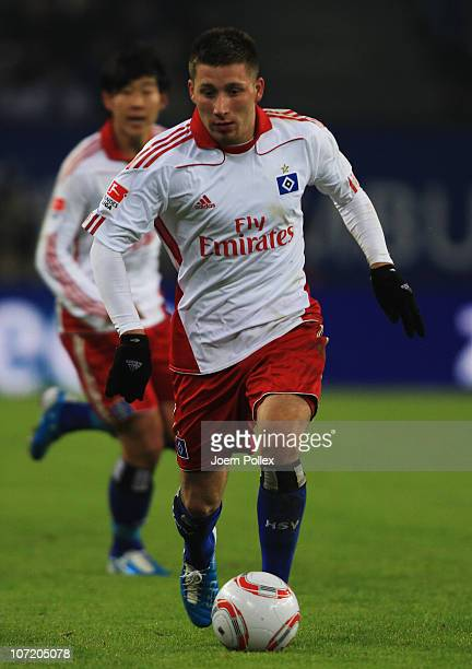 Tunay Torun of Hamburg controls the ball during the Bundesliga match between Hamburger SV and VfB Stuttgart at Imtech Arena on November 27 2010 in...