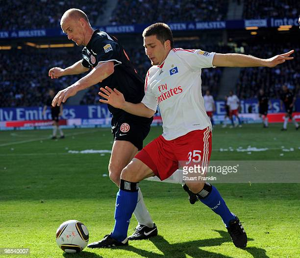 Tunay Torun of Hamburg is challenged by Miroslav Karhan of Mainz during the Bundesliga match between Hamburger SV and FSV Mainz 05 at HSH Nordbank...