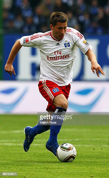Tunay Torun of Hamburg runs with the ball during the Bundesliga match between Hamburger SV and Hannover 96 at HSH Nordbank Arena on April 4 2010 in...