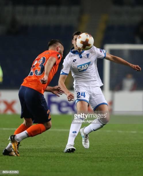 Tunay Torun of Medipol Basaksehir in action against Justin Hoogma of Hoffenheim during the UEFA Europa League Group C soccer match between Medipol...