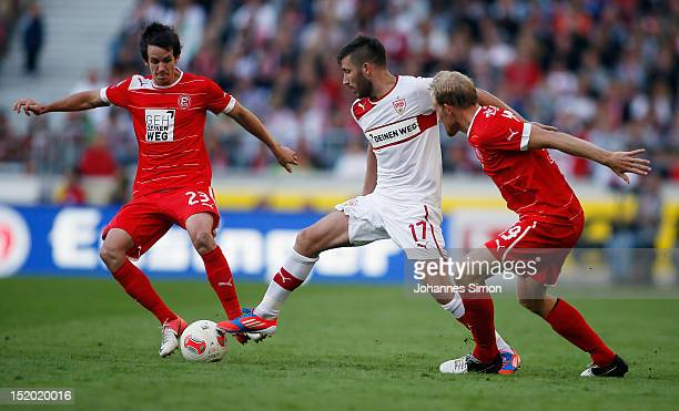 Tunay Torun of Stuttgart and Robbie Kruse and Tobias Levels of Duesseldorf fight for the ball during the Bundesliga match between VfB Stuttgart and...