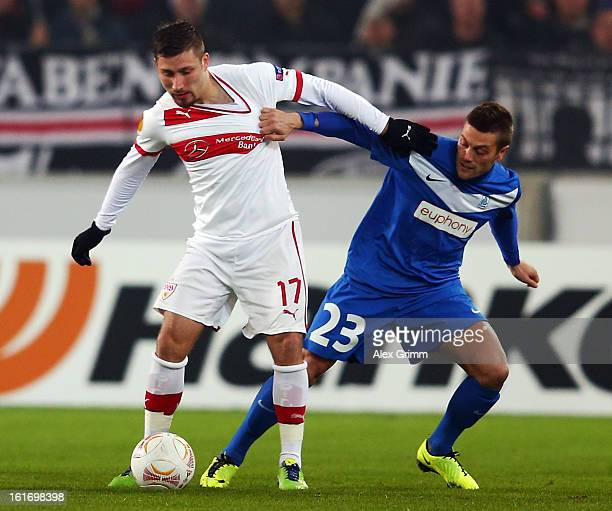 Tunay Torun of Stuttgart is challenged by Benjamin de Ceulaer of Genk during the UEFA Europa League Round of 32 first leg match between VfB Stuttgart...