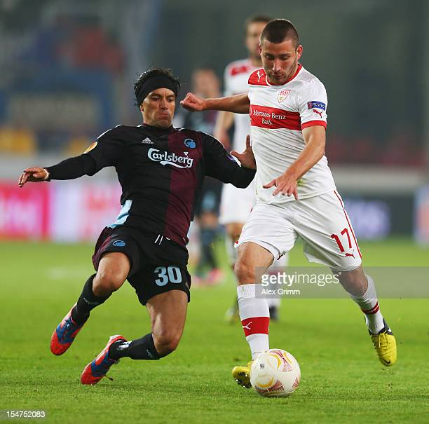 Tunay Torun of Stuttgart is challenged by Christian Bolanos of Copenhagen during the UEFA Europa League group E match between VfB Stuttgart and FC...