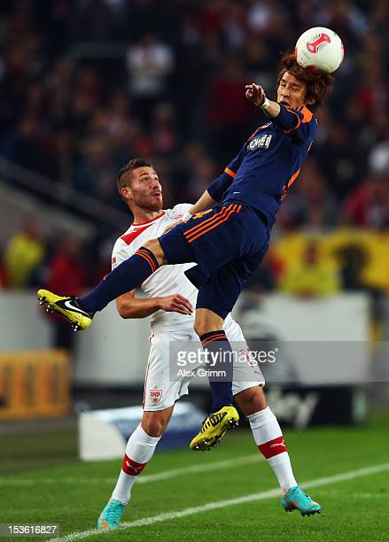 Tunay Torun of Stuttgart is challenged by Hajime Hosogai of Leverkusen during the Bundesliga match between VfB Stuttgart and Bayer 04 Leverkusen at...