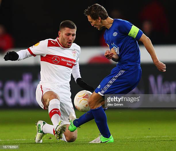 Tunay Torun of Stuttgart is challenged by Magnus Eikrem of Molde during the UEFA Europa League group E match between VfB Stuttgart and Molde FK at...