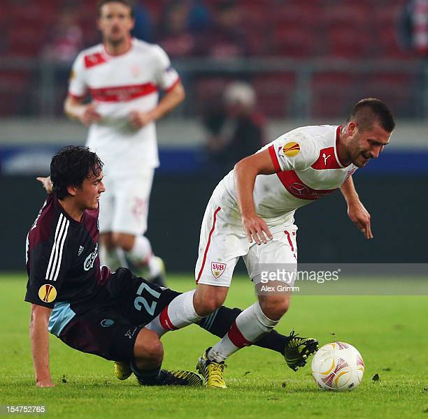 Tunay Torun of Stuttgart is challenged by Thomas Delaney of Copenhagen during the UEFA Europa League group E match between VfB Stuttgart and FC...