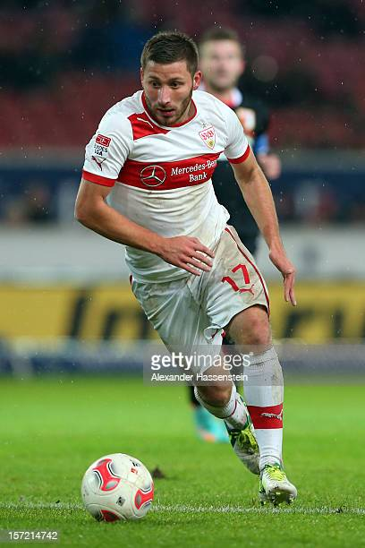 Tunay Torun of Stuttgart runs with the ball during the Bundesliga match between VfB Stuttgart and FC Augsburg at MercedesBenz Arena on November 28...