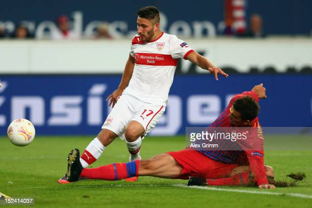 Tunay Torun of Stuttgart tries to score against Lukasz Szukala of Bucuresti during the UEFA Europa League group E match between VfB Stuttgart and FC...