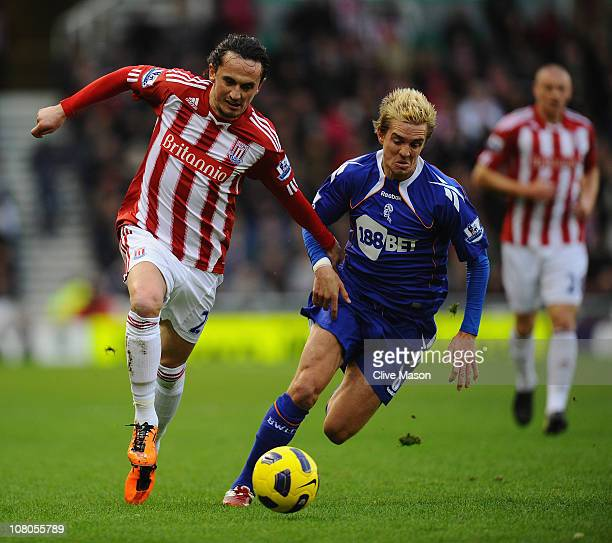 Tuncay of Stoke City holds off a challenge from Stuart Holden of Bolton Wanderers during the Barclays Premier League match between Stoke City and...