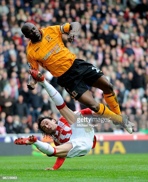 Tuncay of Stoke kicks George Boateng of Hull in the head and knocks him out during the Barclays Premier League match between Stoke City and Hull City...