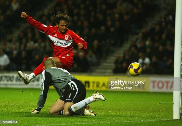 Tuncay Sanli of Middlesbrough scores a goal during the Barclays Premier League match between Hull City and Middlesbrough at the KC Stadium on...
