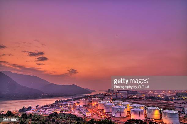 tung chung oil tanks - fuel storage tank stock photos and pictures