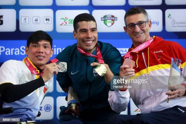 Tung Vo Tanh of Vietnam Daniel Dias of Brazil and Sebastian Rodriguez of Spain pose after the Men's 50m Freestyle S5 Final during day 4 of the Para...