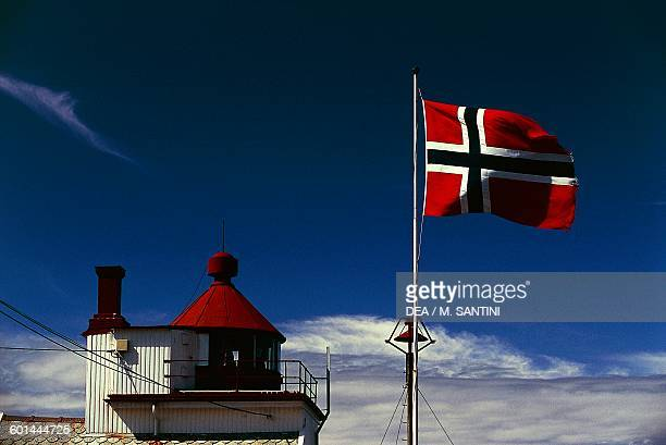Tungenes lighthouse, 1828 and the Norwegian flag, Randaberg, Rogaland County, Norway.