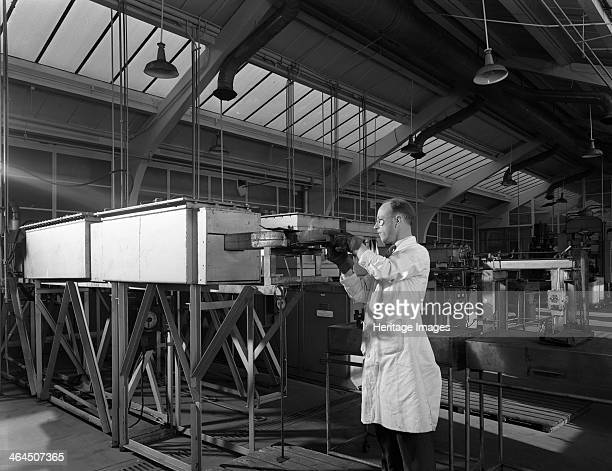 Tungsten carbide furnace being loaded Edgar Allen Steel Co Sheffield South Yorkshire 1962 Tungsten carbide is a chemical compound containing equal...