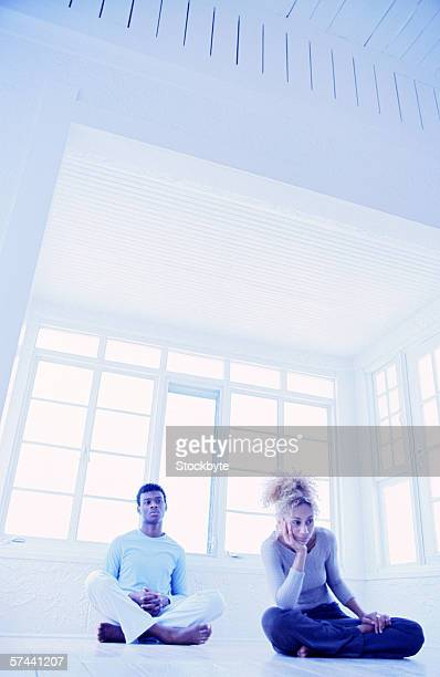tungsten view of a couple sitting on the floor