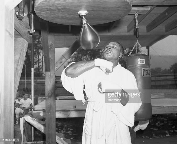 Tuning Up for the Big Fight North Adams Massachusetts Light heavyweight champ Archie Moore who says he's going to knock the heavyweight crown off the...
