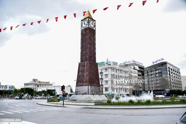 Tunis' famous avenue Habib Bourguiba with the Clock Tower is pictured empty amid of a lockdown due to the Covid-19 pandemic as the country marks 10...
