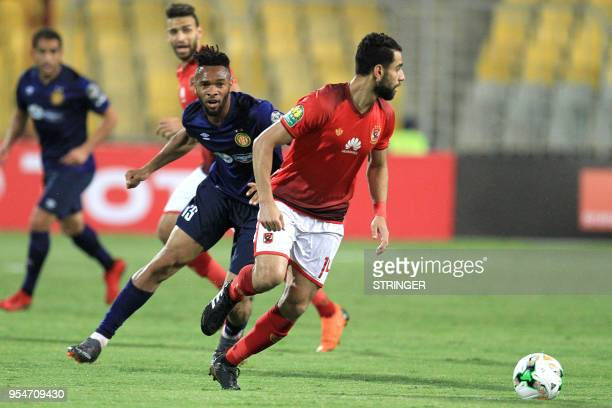 ES Tunis' Ivorian midfielder Fousseny Coulibaly vies for the ball against AlAhly FC's Egyptian midfielder Amr Elsolia during their CAF Champions...
