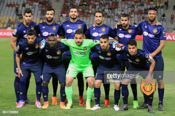 ES Tunis' starting eleven pose for a group picture ahead of their CAF Champions League group A match against AlAhly FC at Borg alArab Stadium near...
