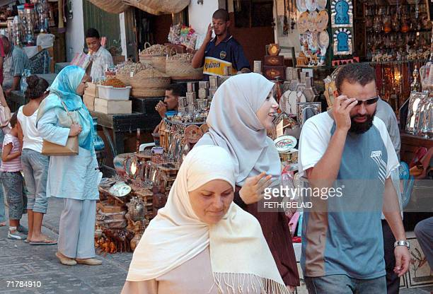 Algerian tourists shop in the Tunis souk 02 September 2006 This summer more than a million Algerians spent their vacations in Tunisia injecting some...