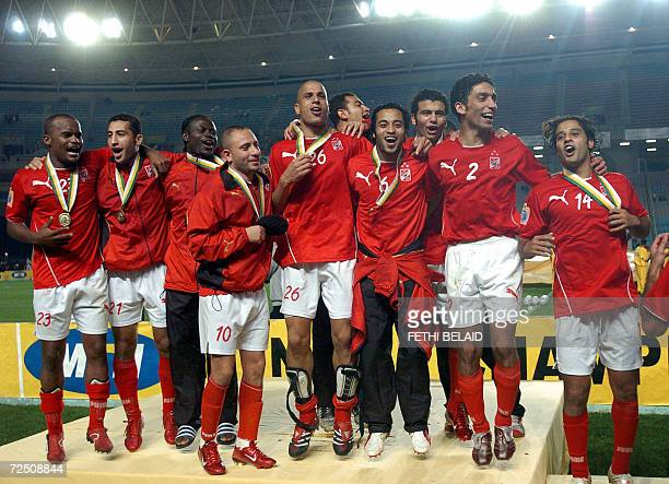 Egyptian AlAhly players celebrate after winning their second leg of the African Champions League final match against Tunisian Sportif Sfaxien 11...