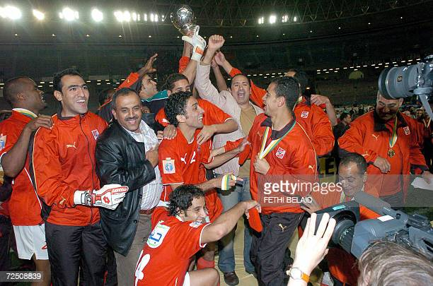 Egyptian AlAhly players hold up the throphy after winning their second leg of the African Champions League final match against Tunisian Sportif...