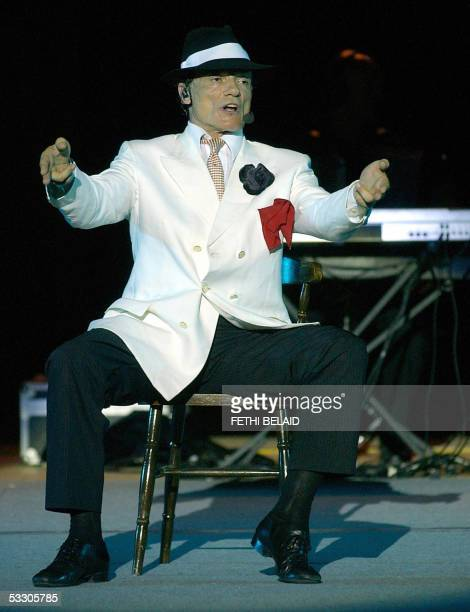 Italian singer Massimo Ranieri performs during the International Carthage festival 29 July 2005 at the Roman Theatre in Carthage near Tunis AFP...
