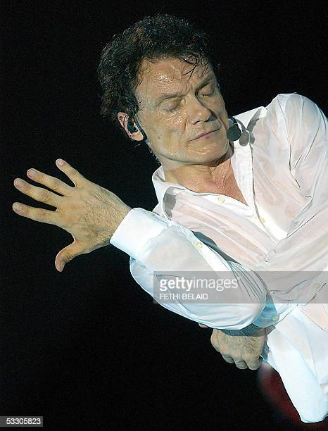 Italian singer Massimo Ranieri performs during the International Carthage festival 29 July 2005 at the Roman Theatre in Carthage near Tunis AFP PHOTO...
