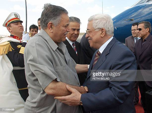 Palestinian leader Mahmud Abbas greets Palestinian Fatah member Abou Maher upon his arrival at Tunis-Carthage international airport 07 August 2006....