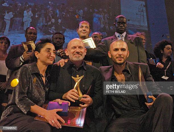 Tunisian director Nouri Bouzid poses with the Tanit d'or for his film Making Off with tunisian best actor Lotfi Abdelli and Tunisian actress Fatma...