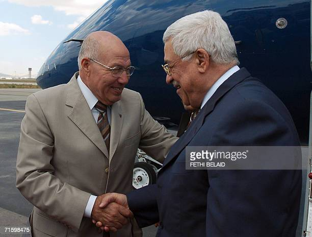 Tunisian government minister and advisor to the president Abdelaziz Ben Dhia greets Palestinian leader Mahmud Abbas upon his arrival at TunisCarthage...
