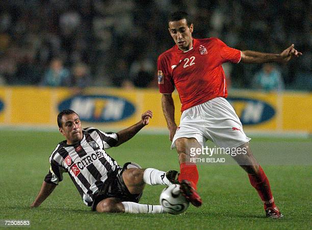 Tunisian Sportif Sfaxien's Amir Belhaj Massoud fights for the ball against Egyptian AlAhly Mohamed Mohamed during their second leg of the African...