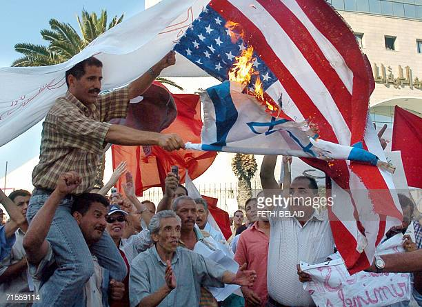 Tunisians burn Israeli and US flags during a protest against the Israeli bombing of Qana 01 August 2006 in Tunis Tunisian President Ben Ali strongly...