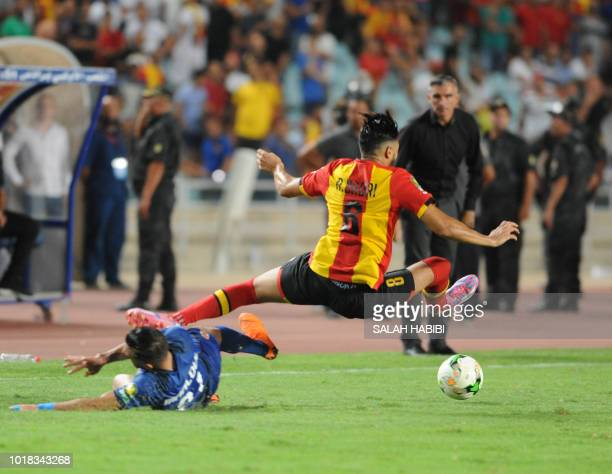 ES Tunis' Tunisian forward Anice Badri leaps for the ball against AlAhly SC's Tunisian defender Ali Maaloul during the CAF Champions League group A...