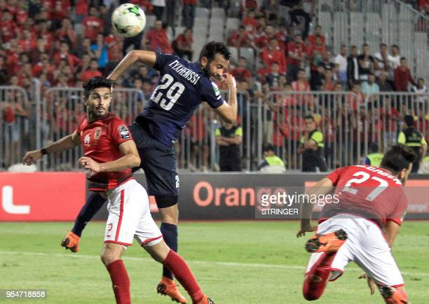 ES Tunis' Tunisian forward Taha Yassine Khenissi jumps to head the ball as he vies against AlAhly FC's Egyptian defender Ayman Ashraf during their...