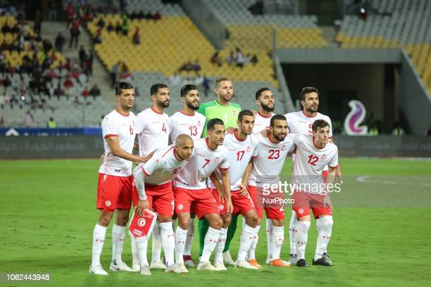 Tunisan footballers pose for a team photo prior to the African Cup of Nations 2019 qualifier football match between Egypt and Tunis at Borg AlArab...