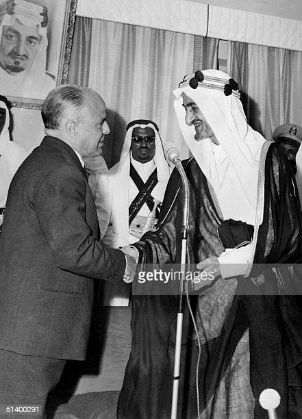 Tunisan President Habib Ben Ali Bourguiba shakes hands with Saudi King Faisal ibn Abd al-Aziz during his visit to the Kingdom of Saudi Arabia....