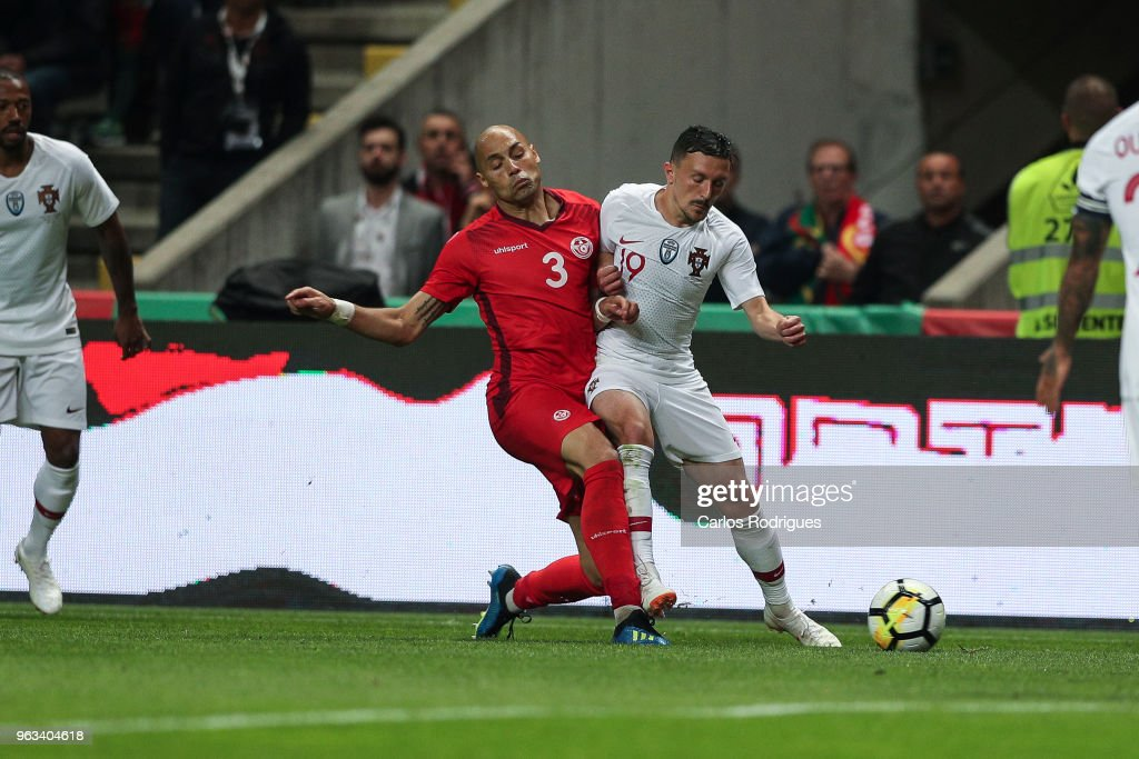 Tunisia defender Yohan Ben Alouane (L) vies with Portugal and SSC Napoli defender Mario Rui (R) for the ball possession during the Portugal vs Tunisia International Friendly match on May 28, 2018 in Braga, Portugal.