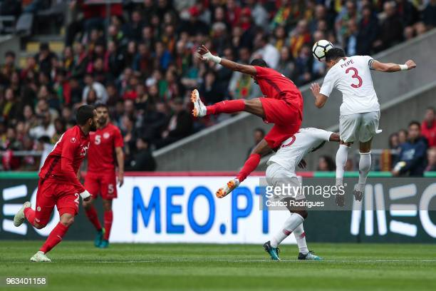 Tunisia forward Saber Khalifa vies with Portugal and Besiktas defender Pepe for the ball possession during the Portugal vs Tunisia International...
