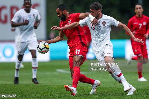 Tunisia forward Saber Khalifa vies with Portugal and SL Benfica defender Ruben Dias for the ball possession during the Portugal vs Tunisia...