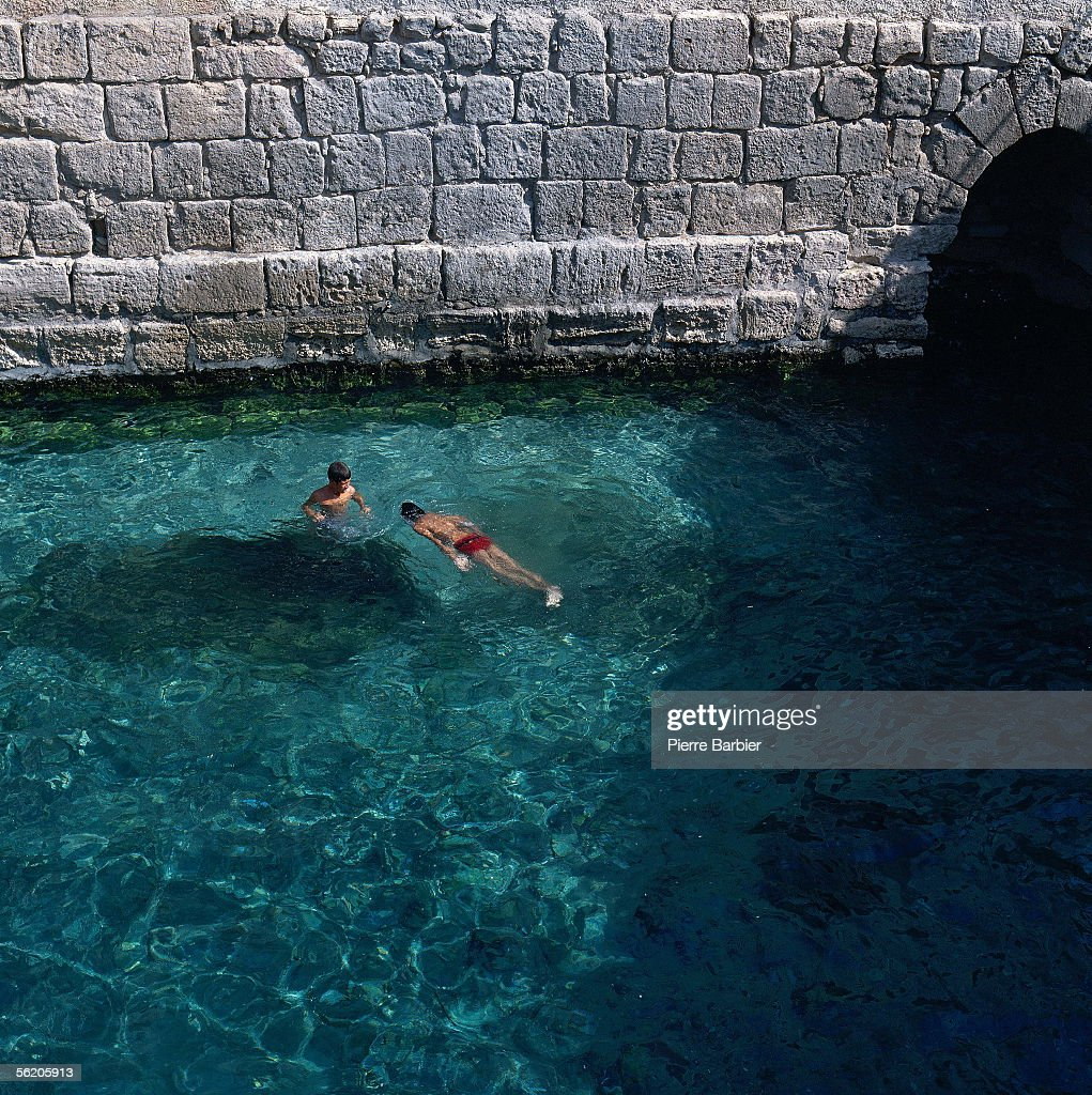 Tunisia. Swimming in an irrigation canal. 1978.