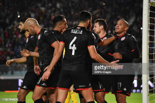 Tunisia team celebrate after scoring during the 2021 Africa Cup of Nations group J qualifying football match between Tunisia and Libya at the Stade...