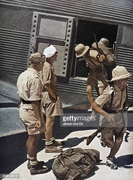 Tunisia World War II German troops landing in North Africa grenadiers disembarking a Ju 52 on a Tunisian airport 1943 Published by 'Signal' 3/1943...