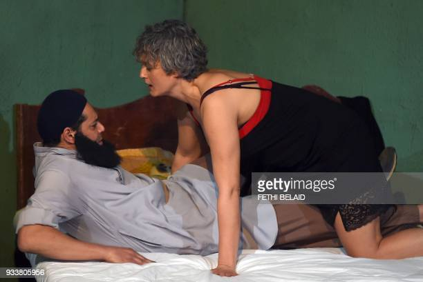 Tunisian actress Nadia Boussetta and actor Ghazi Zaghbani depicting Narjess a prostitute and an Islamist take part in a play entitled ' The Escape'...